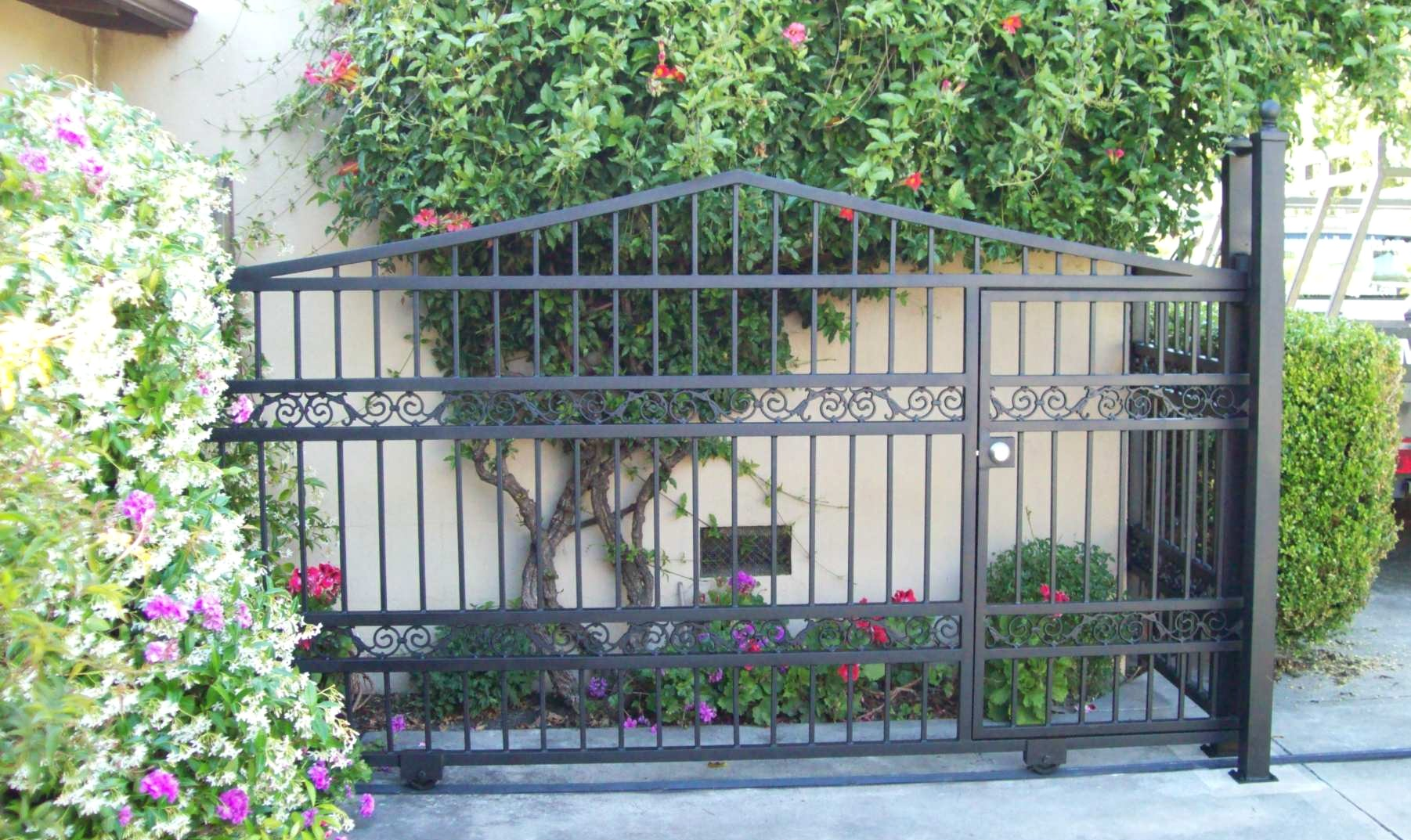 Lovely Iron Gate With Pedestrian Door