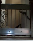Modern Iron Railing With Scroll and Sheet Metal