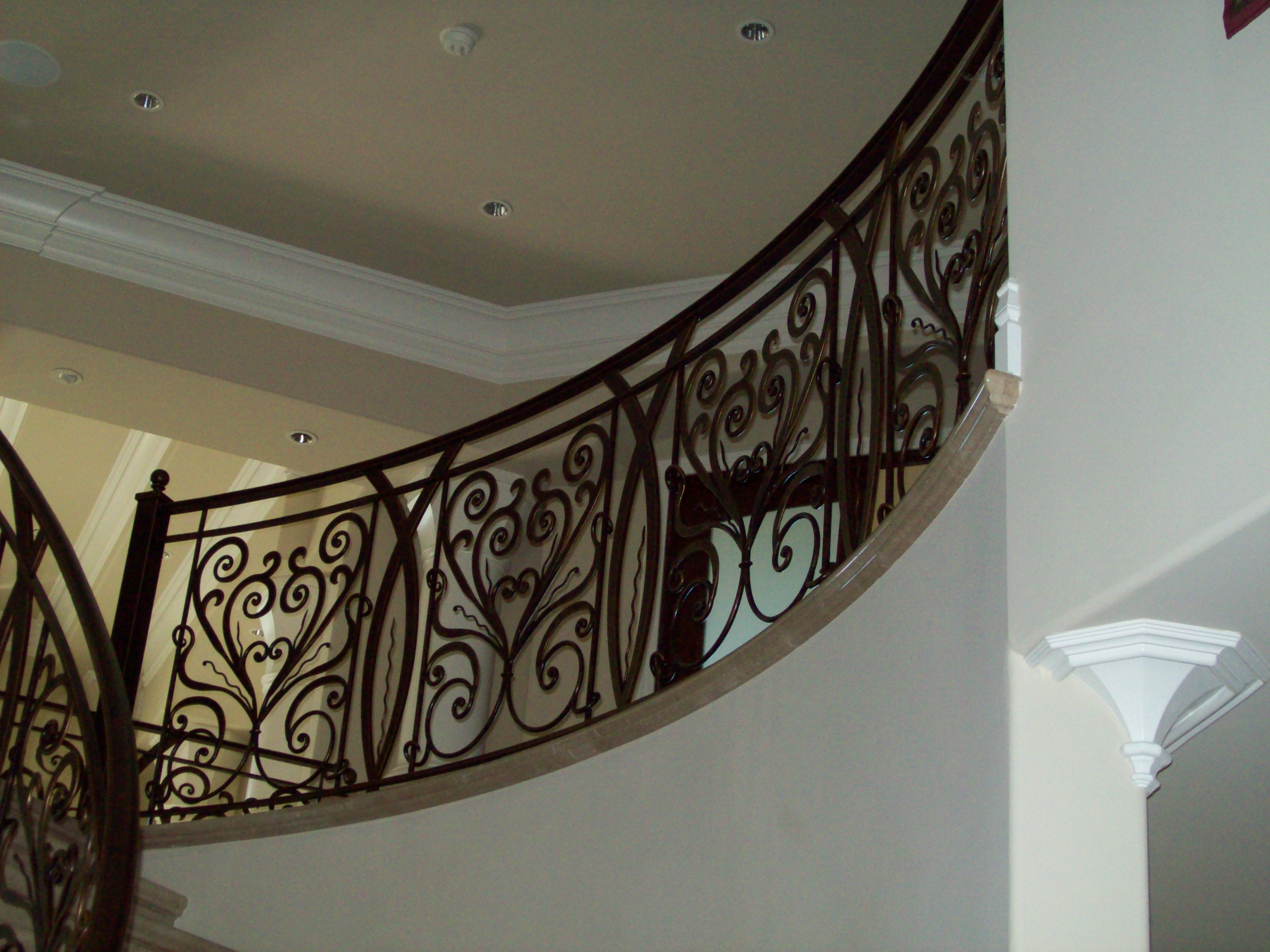Ornamental railing panels - Curved Iron Staircase Railing