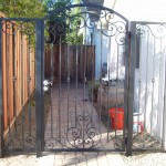 Black Iron Door with scroll and knuckle design